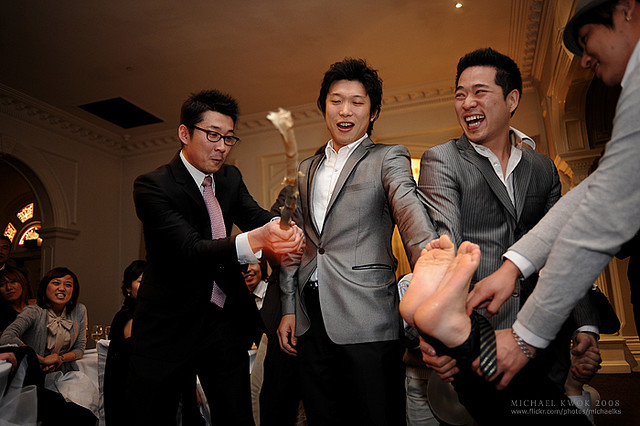 This Is A South Korean Ritual Wherein The Grooms Friends Remove His Shoes And Tie Feet Together They Then Lift Hit Soles With Stick